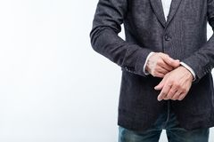 Business man adjusting sleeve success confidence. Business man adjusting sleeve. success and confidence concept. white background stock photography