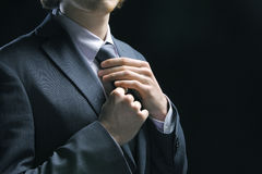 Business man adjusting tie Royalty Free Stock Photos