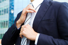 Business man adjusting tie Stock Photo