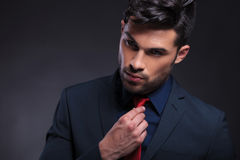 Business man adjusts his tie Stock Photography