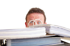 Business man afraid of tax audit. Hinding behind files Stock Images