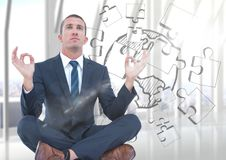 Business man against blurry window with flare and jigsaw doodle Royalty Free Stock Image