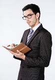 Business man with agenda Royalty Free Stock Photos
