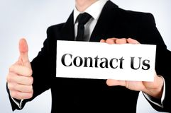 Business man agreement. Business man showing Contact us word stock photo
