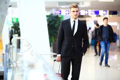 Business man at airport with suitcase. Travel concept stock photo