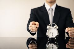 Business man with alarm clock. royalty free stock photography