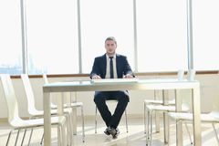 Business man alone in conference room Royalty Free Stock Photos