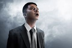 Business man amaze on smoke background. Business man amazed on smoke background royalty free stock photography