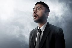 Businessman amazed on smoke background. Business man amazed on smoke background Royalty Free Stock Image