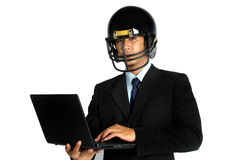 Business man  american football helmet hold notebook Royalty Free Stock Image