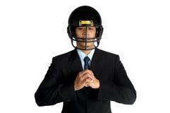Business man  american football helmet Royalty Free Stock Photo