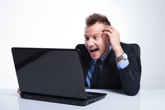 Business man amused by his laptop Stock Photo