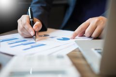 Business man analysed report of profit finance data graph docume. Nt in his office Stock Images