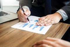 Business man analysed report of profit finance data graph docume. Nt in his office Royalty Free Stock Photo