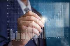 Business man analyzes the profit chart. Royalty Free Stock Photography
