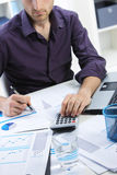 Business man analyzing financial data Stock Images
