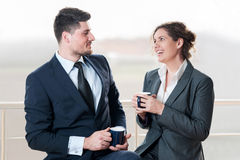 Business man andwoman chatting over coffee Stock Image