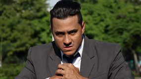 Business Man And Anger. A handsome young hispanic man Royalty Free Stock Image