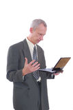 Business man angry and laptop. Photograph showing business type male with laptop computer isolated Stock Photos