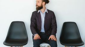 Business man apprehension anxiety appointment. Business guy. Apprehension and anxiety. Young bearded man waiting for appointment. Worried concerned fidgety stock video