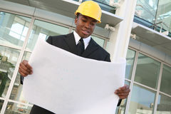 Business Man Architect. A young man working as an architect on a building site royalty free stock photography