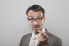 Business man argues. Determinated business man with stubble argues by pointing his forefinger stock images