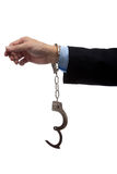 Business man arm in handcuffs Stock Photography