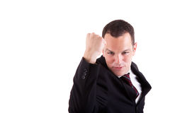 Business man with arm raised in victory sign Stock Photo