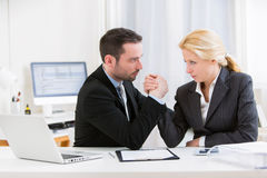 Business man arm wrestling at the office Royalty Free Stock Images