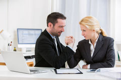 Business man arm wrestling at the office Stock Image