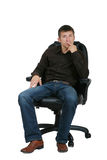 Business man in the armchair royalty free stock image