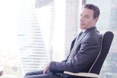 Business man on armchair Stock Photography