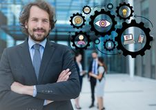Business man with arms folded and black gear graphics Royalty Free Stock Photo