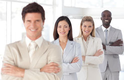 Business man with arms folded with Business Team Stock Image