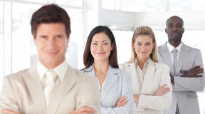 Business man with arms folded with Business Team Stock Photography