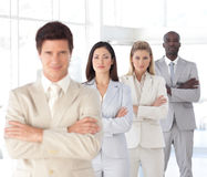 Business man with arms folded with Business Team Stock Photos
