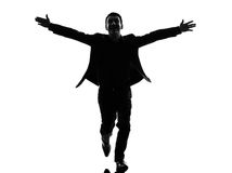 Business man arms outstretched silhouette Royalty Free Stock Image