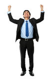Business man with arms raised. Excited business man with arms raised in success - Isolated on white Royalty Free Stock Photo