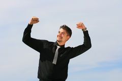 Business man with arms raised. Ecstatic man receives news of his success Stock Image