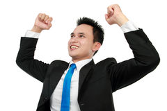 Business man with arms raised in success. Cheerful asian business man with arms raised in success isolated on white background Stock Photo