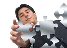 Business man arranging puzzle on white Stock Images