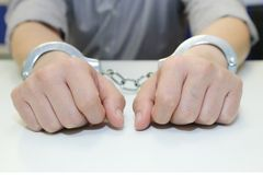 Business man arrested with handcuffs Royalty Free Stock Image
