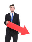Business Man Arrow Down. A business man holding a red arrow down indicating failure Royalty Free Stock Images
