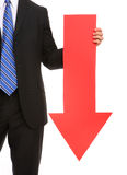 Business Man Arrow Down. A business man holding a red arrow down indicating failure Royalty Free Stock Photography