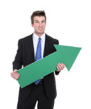 Business Man Arrow Up. A business man holding a green arrow up indicating success Royalty Free Stock Image