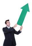 Business Man Arrow Up. A business man holding a green arrow up indicating success Stock Photos