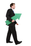 Business Man Arrow Up. A business man holding a green arrow up indicating success Royalty Free Stock Photography