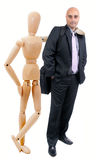 Business man and articulated doll Royalty Free Stock Images