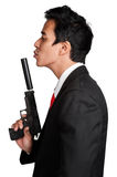 Business man asian hold gun in suit Royalty Free Stock Images