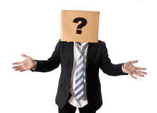 Business man asking for help with cardboard box on his head Stock Images